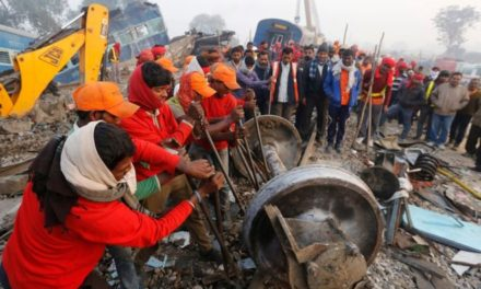 India train: Rescuers comb through mangled wreckage