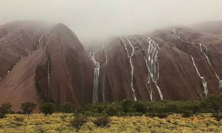 Three people missing in Central Australia after record-breaking rainfall and flooding
