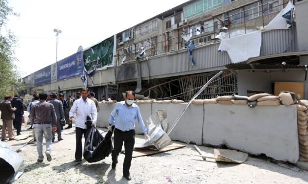 Suicide bomber hits Kabul bank, amid reports of deadly airstrike