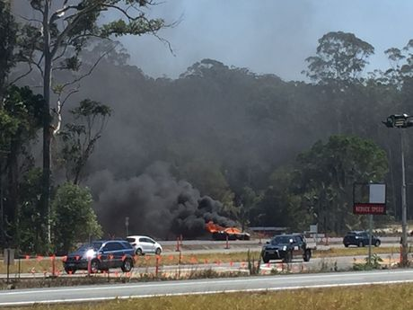 Car explodes into flames on Bruce Hwy, massive delays