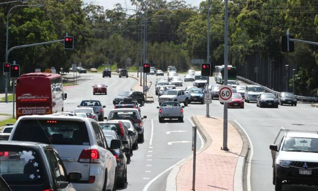 Gold Coast police reopen busy Southport intersection after three people rushed to hospital in car crash