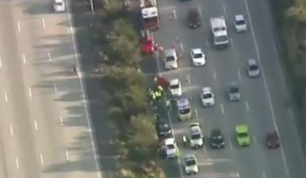 Man dies after being hit by two cars in Pacific Motorway crash on the Gold Coast
