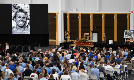 Mourners arrive for ironman champion Dean Mercer's funeral