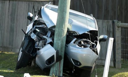 Car crashes into power pole on major Coast road