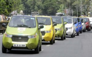 Electric Cars rally, during awareness campaign by Mahindra to create consciousness about environmental degeneration and the need for alternative mode of transport, in Bangalore on June 28, 2014. (Photo: IANS)