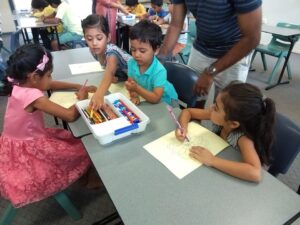 Kids participating in rangoli colouring competition