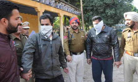 Two held for assaulting NRI