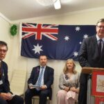 Senator Paul Scarr speaking as Lewis Lee OAM (left), Mr Graham Perrett MP (2nd left) and Cr Angela Owen look on
